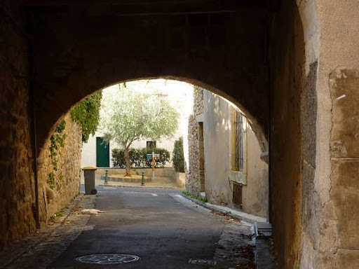 Montblanc, Languedoc, Fra,ce a medieval archway to the town center near Villa Roquette B&B